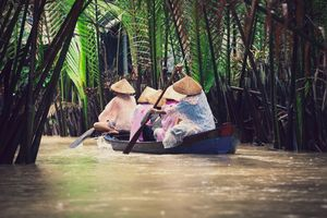 Vietnamese people on a small vessel