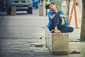 Vietnam, man lying on the street