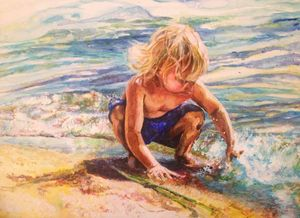 Boy playing in water shoreline
