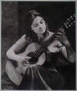 Women playing Spanish guitar