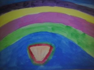 bright rainbow over seashell