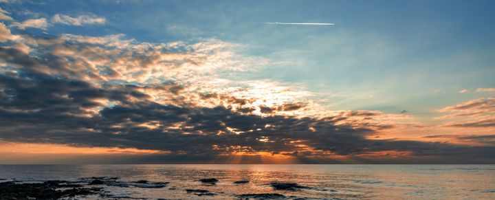 Sunset at the beach - Marin Gelussi