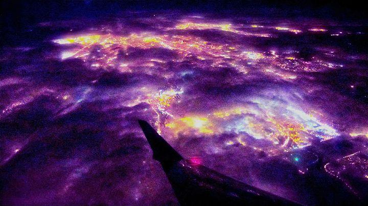NEW YORK CITY LIGHTS UNDER CLOUDS - Tirzah Fujii