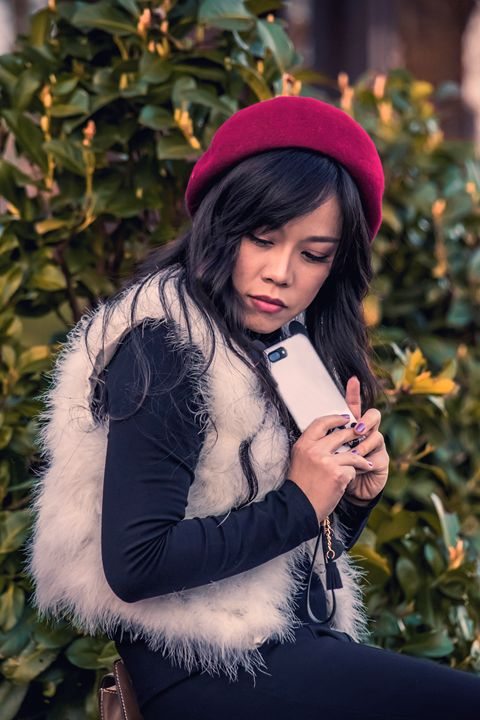 Pretty asian girl with cell phone - Willcobain