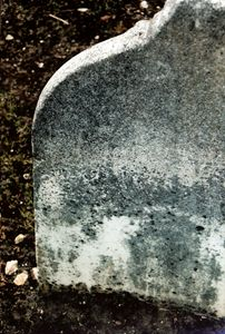 an upright stone at the old mission