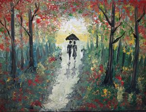Couple walking under umbrella
