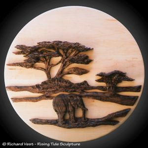 Silhouette Elephant Wall Carving