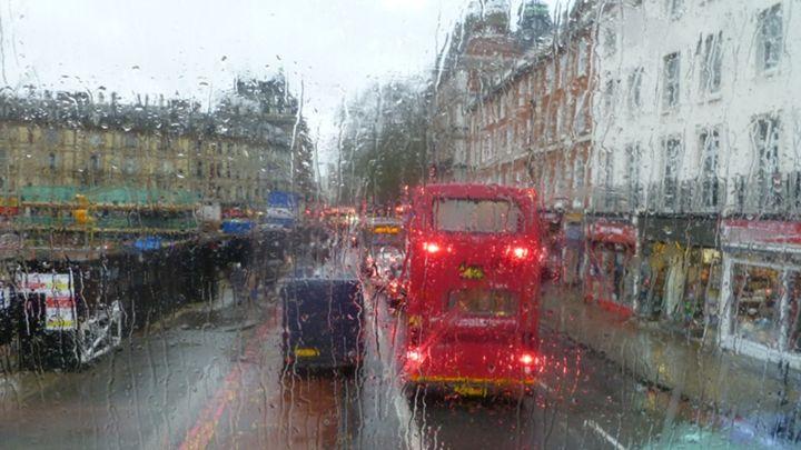 Riding a red double decker in London - Leon Szymanski