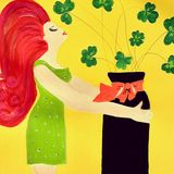 Red haired girl with vase of shamroc