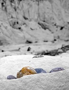 Colored Pebbles On Black And White
