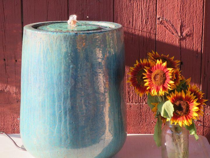 still life ,sunflower,clay fountain. - L'Orangerie