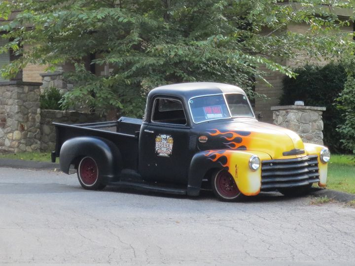 flaming pick up truck - L'Orangerie