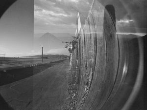 Fence and horizon, multiple exposure