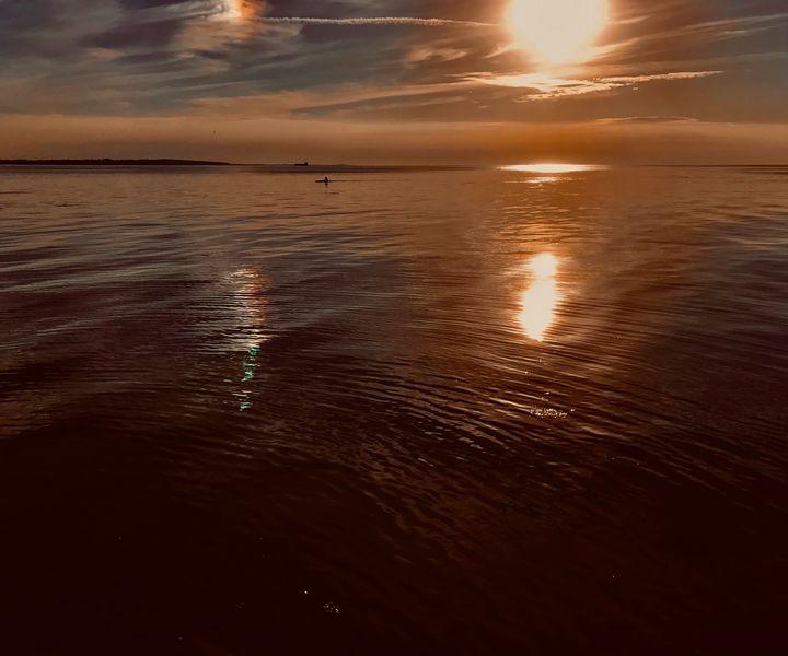 Canoeist on a still sea - HenrikG Photography