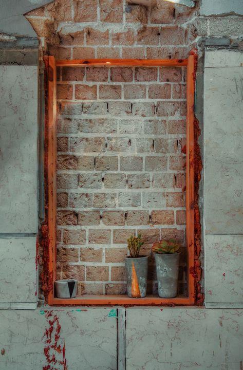 Window sealed with red bricks - Maor Winetrob