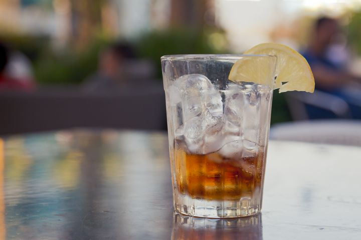 Glass with cola, ice and lemon - Maor Winetrob