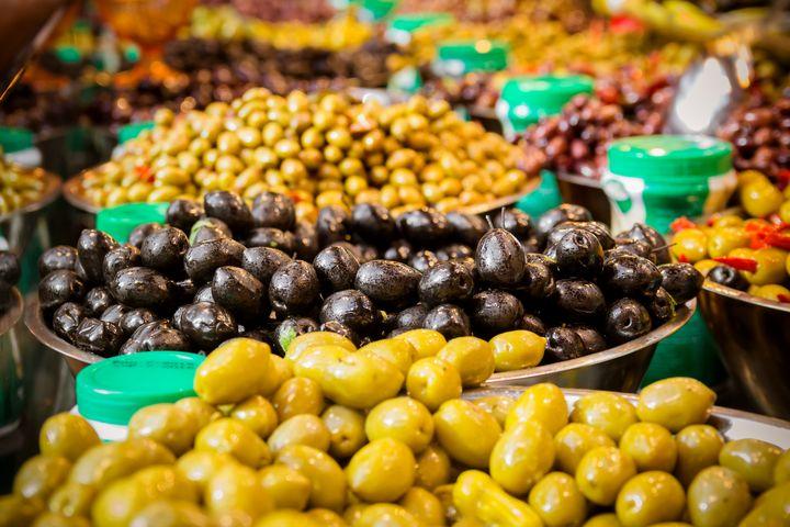 Olives at a market stall - Maor Winetrob