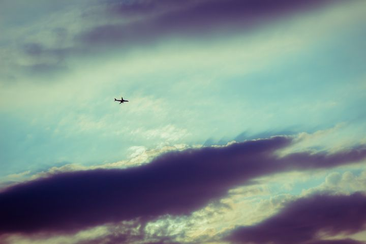Silhouette of an airplane flying in - Maor Winetrob