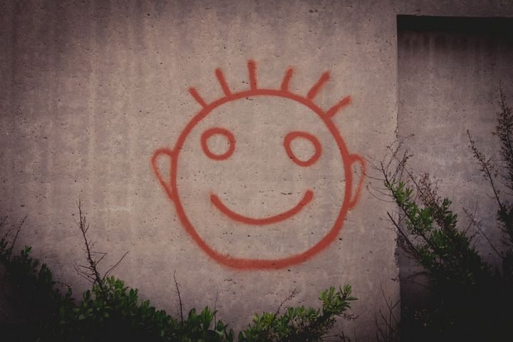 Graffiti painting of red happy smile - Maor Winetrob