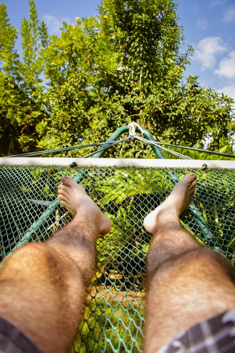 Man laying in hammock - Maor Winetrob