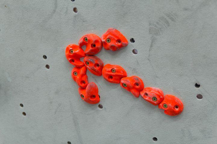 Arrow shape red climbing holds - Maor Winetrob