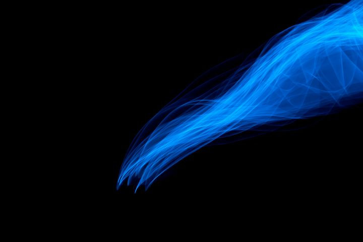 Glowing abstract curved blue lines - Maor Winetrob