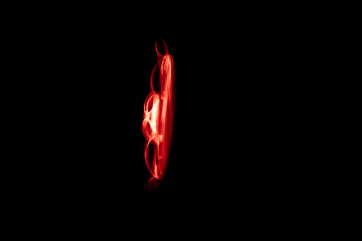Glowing abstract curved red lines - Maor Winetrob