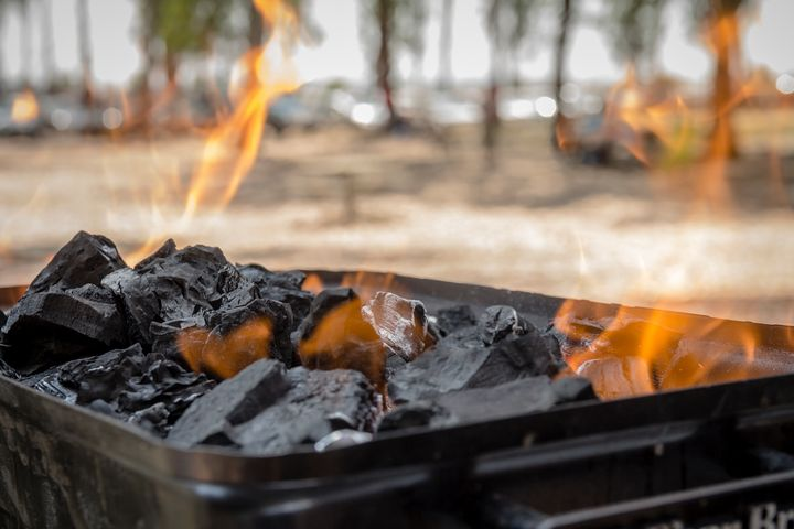 Coals are burned in a BBQ grill - Maor Winetrob