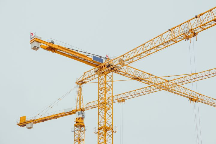 Many yellow construction cranes - Maor Winetrob