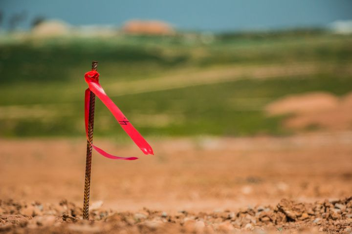 Metal survey peg with red flag - Maor Winetrob