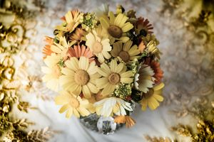a vase of yellow daisies flowers