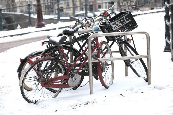Bikes in winter snow outside. - oscarcwilliams