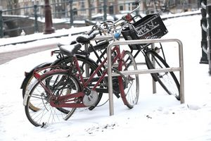 Bikes in winter snow outside.