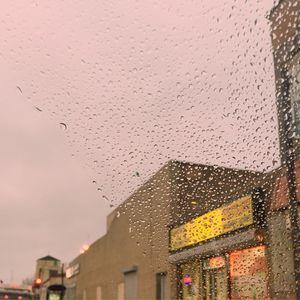 Paste Urban landscape with rain