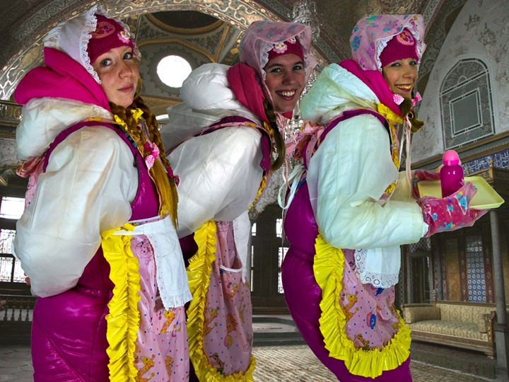 scullerymaids in Arabia - maids in plastic clothes