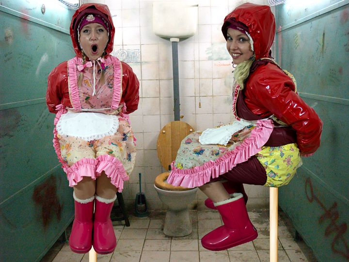 two loomaids - maids in plastic clothes