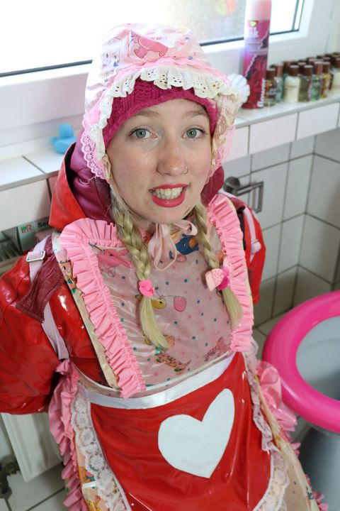 the toilet whore ready for service - maids in plastic clothes