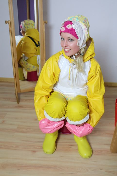 cute littleone in rubber clothes - maids in plastic clothes
