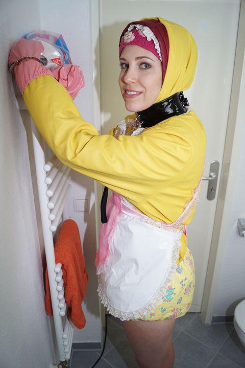 Tyttö odottaa - maids in plastic clothes