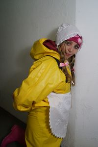 whore in yellow rubber clothing