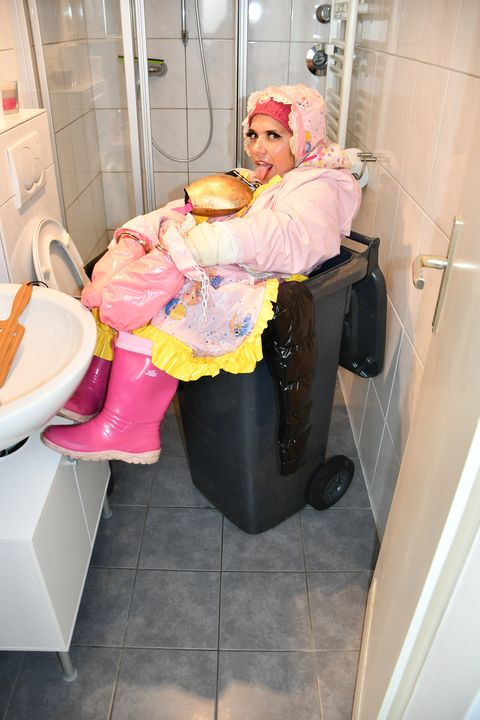 Trash can bathroom - maids in plastic clothes