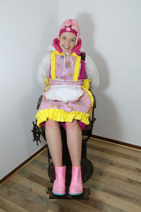 maid dermapadrusnika in barber chair - maids in plastic clothes