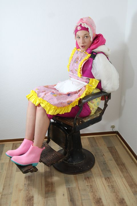 maid derampadrusnika in barber chair - maids in plastic clothes