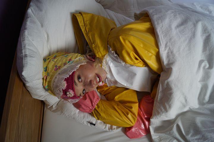 maid deram Padrusnika in bed - maids in plastic clothes