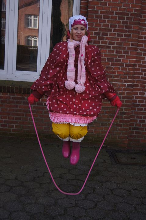 A scullery maid jumps jump rope - maids in plastic clothes