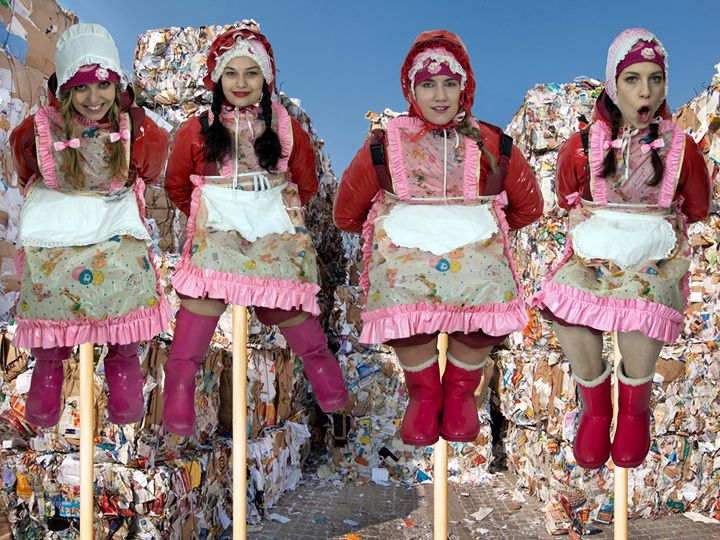 maids decorating waste disposal site - maids in plastic clothes