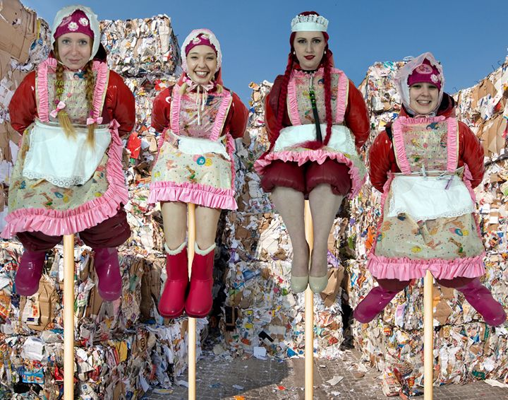 maids at a waste disposal - maids in plastic clothes