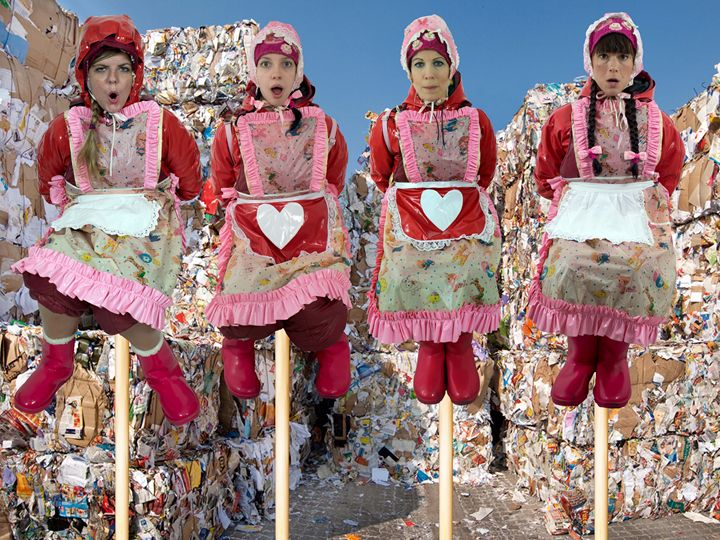 maids decorating a waste disposal - maids in plastic clothes