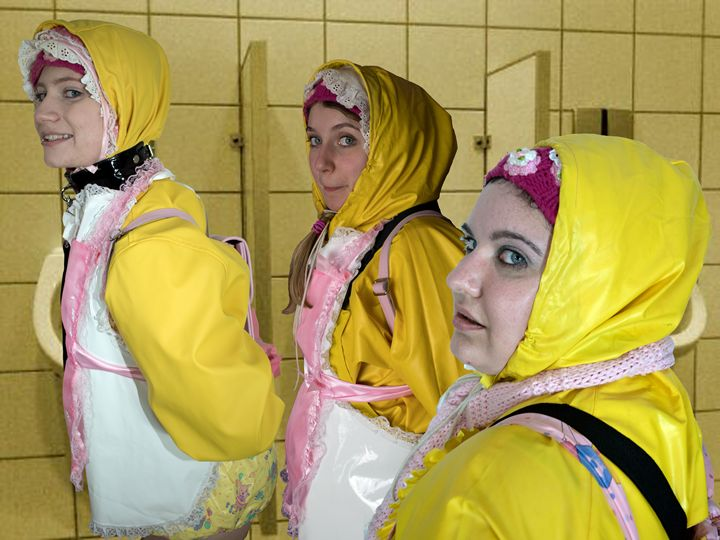 3 toilet-maids in Friesennerz - maids in plastic clothes
