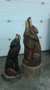 Male and female Howling Wolves - Cochrane Creations Chainsaw Carving